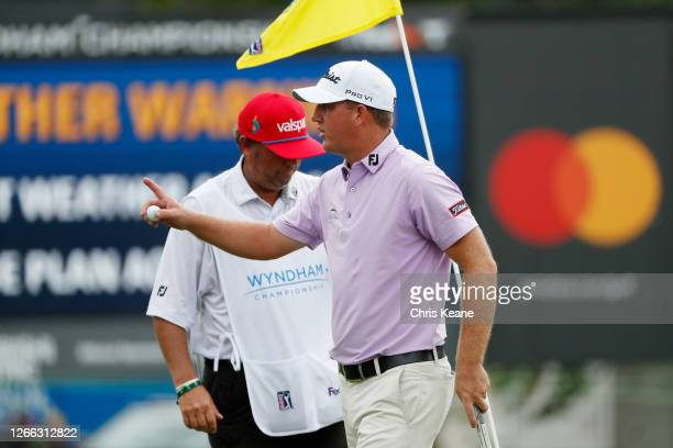 Tom Hoge of the United States reacts on the ninth green during the second round of the Wyndham Championship at Sedgefield Country Club on August 14,...