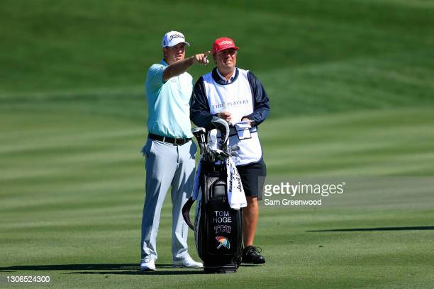 Tom Hoge of the United States talks with his caddie on the fourth hole during the first round of THE PLAYERS Championship on THE PLAYERS Stadium...