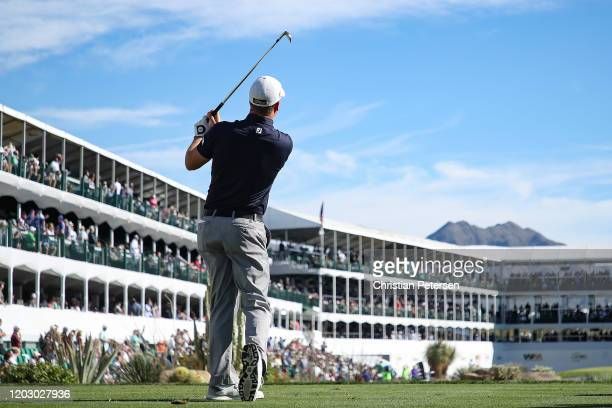 Tom Hoge plays his shot from the 16th tee during the first round of the Waste Management Phoenix Open at TPC Scottsdale on January 30, 2020 in...