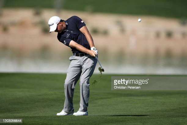 Tom Hoge plays his shot on the 15th hole during the first round of the Waste Management Phoenix Open at TPC Scottsdale on January 30, 2020 in...