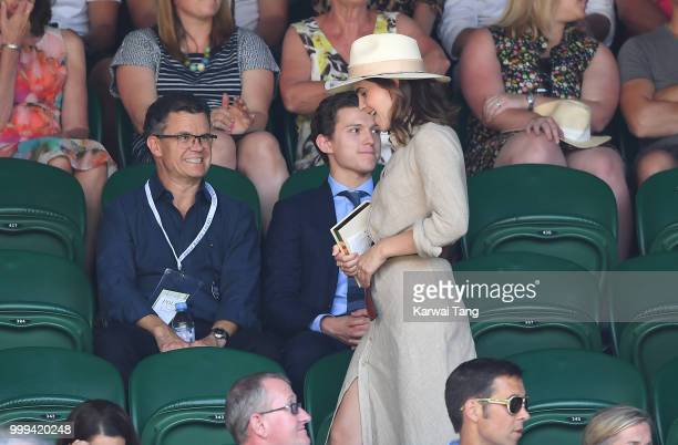 Tom Holland and and his father Dominic Holland and Emma Watson attend the men's singles final on day thirteen of the Wimbledon Tennis Championships...