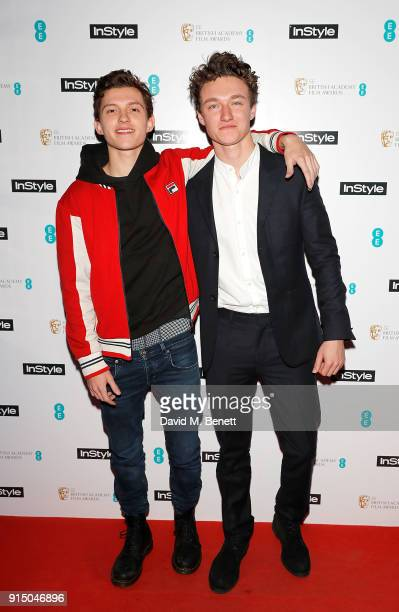 Tom Holland and Harrison Osterfield attend the InStyle EE Rising Star Party Ahead Of The EE BAFTAs at Granary Square on February 6 2018 in London...