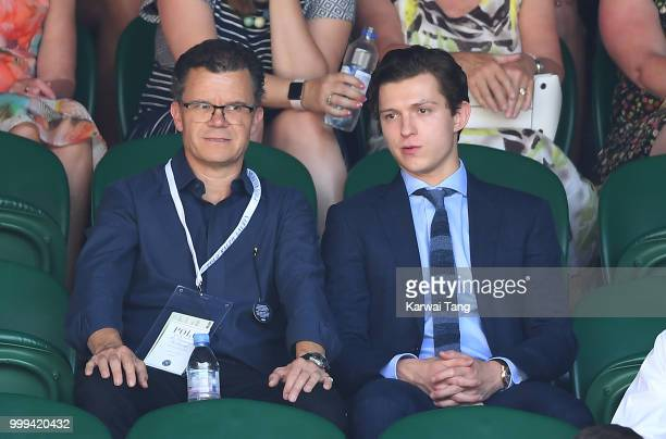 Tom Holland and his father Dominic Holland attend the men's singles final on day thirteen of the Wimbledon Tennis Championships at the All England...