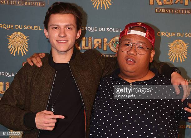 Tom Holland and Jacob Batalon pose at The Opening Night of Cirque du Soleil Kurios Cabinet Of Curiosities at Randall's Island Park on September 29...