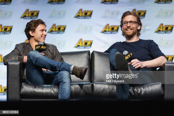 Tom Holland and Tom Hiddleston speak on stage during ACE Comic Con at WaMu Theatre on June 24, 2018 in Seattle, Washington.