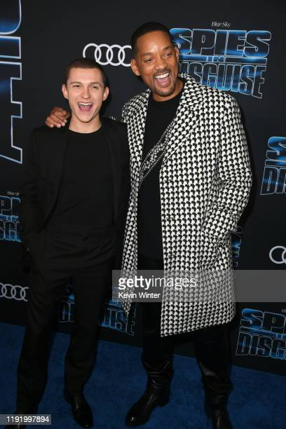 Tom Holland and Will Smith attend the premiere of 20th Century Fox's Spies In Disguise at El Capitan Theatre on December 04 2019 in Los Angeles...