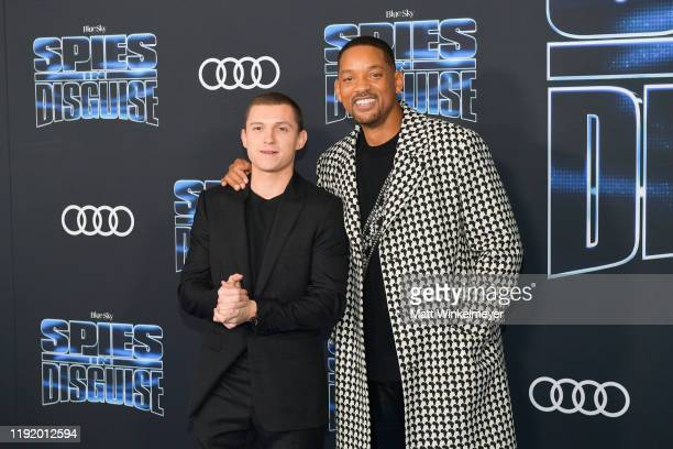 Tom Holland and Will Smith attends the premiere of 20th Century Fox's Spies In Disguise at El Capitan Theatre on December 04 2019 in Los Angeles...