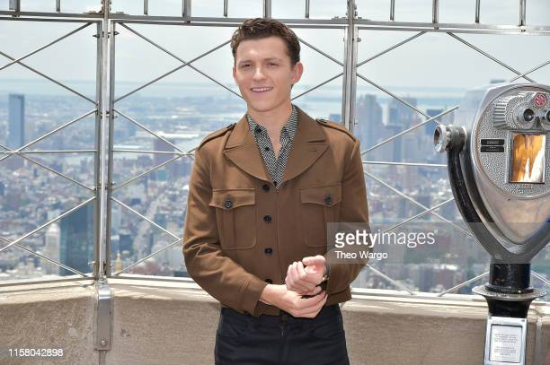 Tom Holland attends Stars Of SpiderMan Far From Home Light The Empire State Building at The Empire State Building on June 24 2019 in New York City