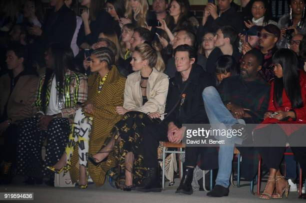 Tom Holland guest Zendaya Lily James Matt Smith Idris Elba and Sabrina Dhowre wearing Burberry at the Burberry February 2018 show during London...