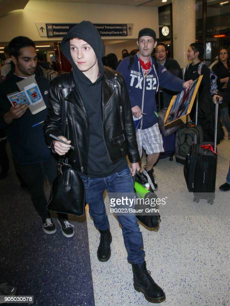 Tom Holland is seen at Los Angeles International Airport on January 14 2018 in Los Angeles California