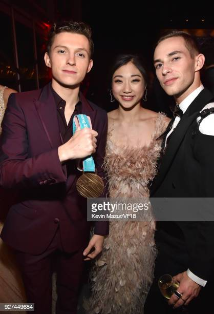 Tom Holland Mirai Nagasu and Adam Rippon attend the 2018 Vanity Fair Oscar Party hosted by Radhika Jones at Wallis Annenberg Center for the...