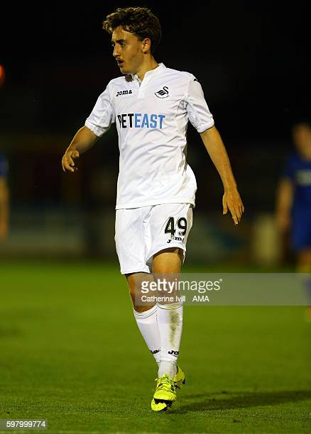 Tom Holland of Swansea City during the Checkatradecom Trophy match between AFC Wimbledon and Swansea City at The Cherry Red Records Stadium on August...