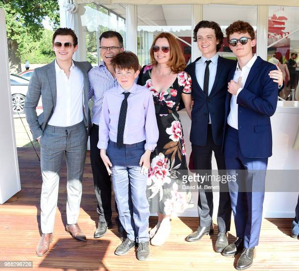 Tom Holland poses with his family Dominic Holland Paddy Holland Nicola Holland Sam Holland and Harry Holland at the Audi Polo Challenge at Coworth...