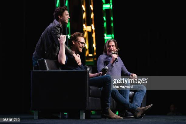 Tom Holland surprises Tom Hiddleston on stage during ACE Comic Con at WaMu Theatre on June 24 2018 in Seattle Washington