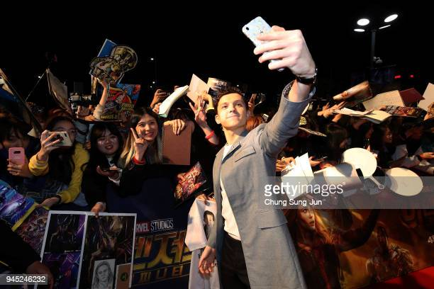 Tom Holland takes a selfie at the Seoul premiere of 'Avengers Infinity War' on April 12 2018 in Seoul South Korea