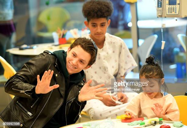 Tom Holland visits with children in support of Marvel's The Universe Unites at LACUSC Medical Center on March 1 2018 in Los Angeles California...