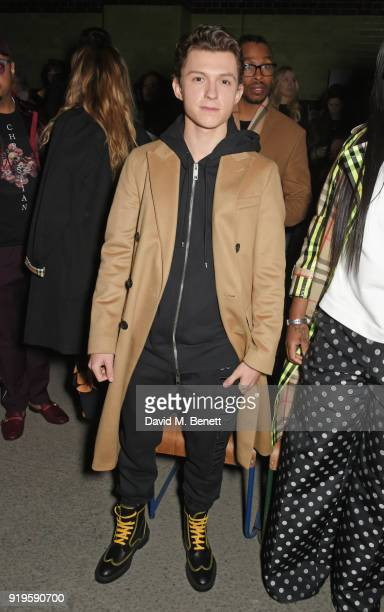 Tom Holland wearing Burberry at the Burberry February 2018 show during London Fashion Week at Dimco Buildings on February 17 2018 in London England
