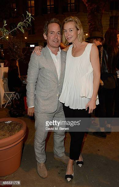Tom Hollander and Zoe Kuipers attends Club Monaco Sloane Square event to celebrate Women's Flagship Store opening on September 12 2014 in London...