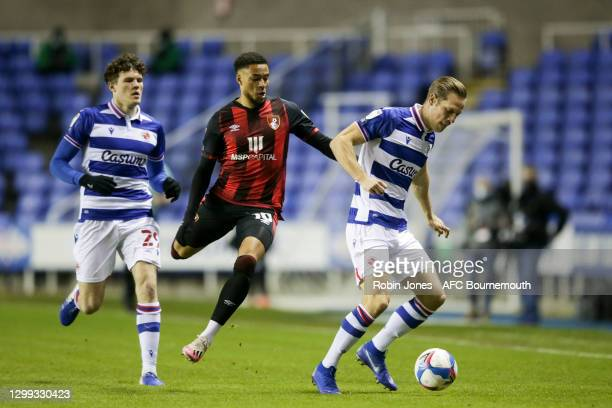 Tom Holmes and Michael Morrison of Reading FC close out Arnaut Danjuma of Bournemouth during the Sky Bet Championship match between Reading and AFC...