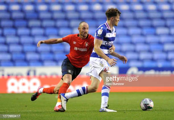 Tom Holmes of Reading FC is pulled back by Danny Hylton of Luton Town during Carabao Cup Second Round match between Reading FC and Luton Town at...