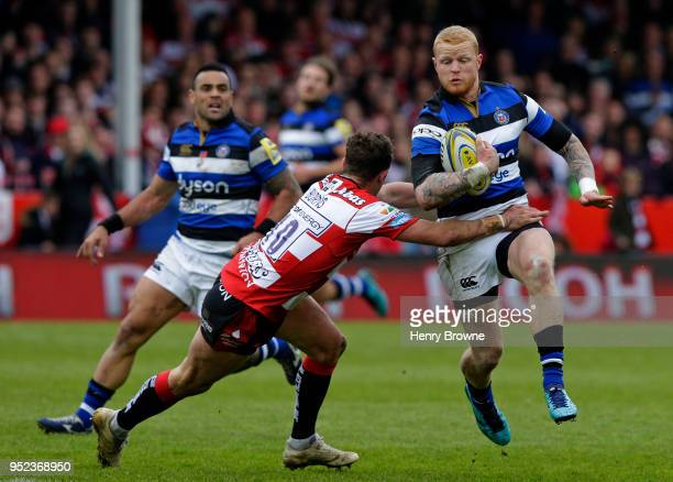 Tom Homer of Bath avoids Billy Burns of Gloucester and runs in their fourth try during the Aviva Premiership match between Gloucester Rugby and Bath...