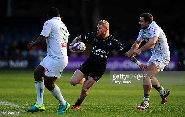 Tom Homer of Bath Rugby is tackled by Pierre Dupouy of Pau during the European Rugby Challenge Cup match between Bath Rugby and Pau at the Recreation...