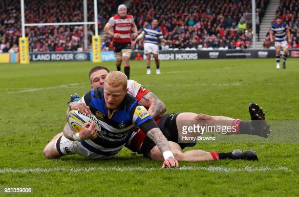Tom Homer of Bath scores their fourth try despite the efforts of Jason Woodward of Gloucester during the Aviva Premiership match between Gloucester...
