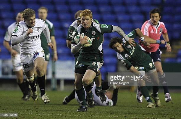 Tom Homer of London Irish races away with the ball during the Heineken Cup match between London Irish and Brive at the Madejski Stadium on December...