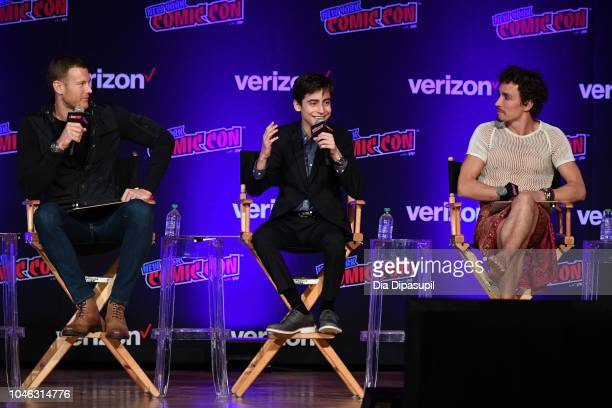 Tom Hopper Aidan Gallagher and Robert Sheehan speak onstage at the Netflix Chills panel during New York Comic Con 2018 at Jacob K Javits Convention...