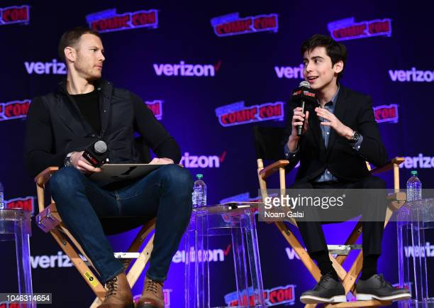 Tom Hopper and Aidan Gallagher speak onstage at the Netflix Chills panel during New York Comic Con 2018 at Jacob K Javits Convention Center on...