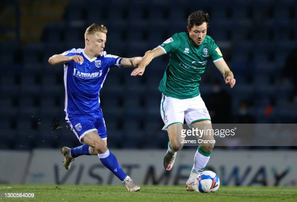 Tom Hopper of Lincoln City battles for possession with Kyle Dempsey of Gillingham FC during the Sky Bet League One match between Gillingham and...
