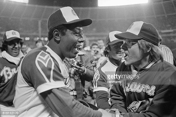 Tom House congratulates Hank Aaron on his 715th home run hit in this photograph House retrieved the homer