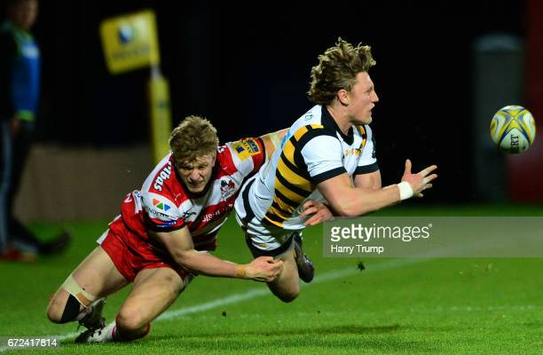 Tom Howe of Wasps A is tackled by Ollie Thorley of Gloucester United during the Aviva A League Semi Final match between Gloucester United and Wasps...