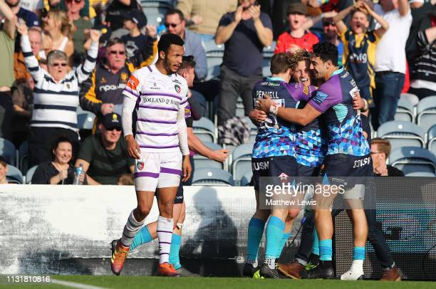 Tom Howe of Worcester Warriors is congratulated on his try during the Gallagher Premiership Rugby match between Worcester Warriors and Leicester...