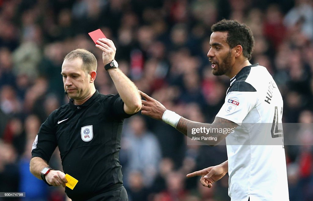 Tom Huddleston of Derby County is shown a red card during the Sky Bet Championship match between Nottingham Forest and Derby County at City Ground on March 11, 2018 in Nottingham, England.