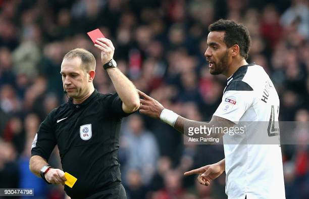 Tom Huddleston of Derby County is shown a red card during the Sky Bet Championship match between Nottingham Forest and Derby County at City Ground on...