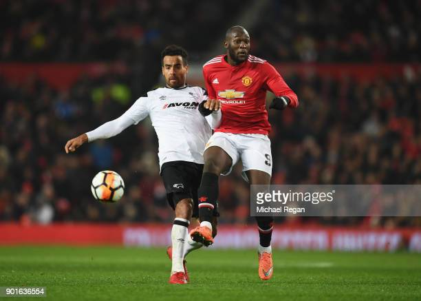 Tom Huddlestone of Derby County and Romelu Lukaku of Manchester United battle for the ball during the Emirates FA Cup Third Round match between...