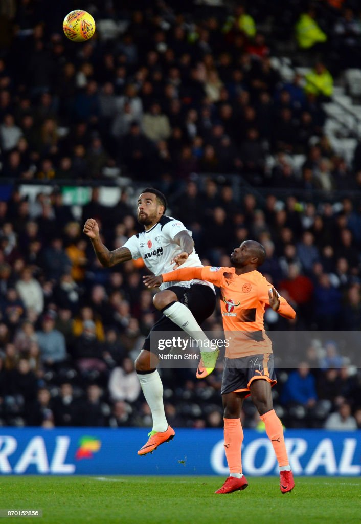 Tom Huddlestone of Derby County and Sone Aluko of Reading in action during the Sky Bet Championship match between Derby County and Reading at iPro Stadium on November 4, 2017 in Derby, England.