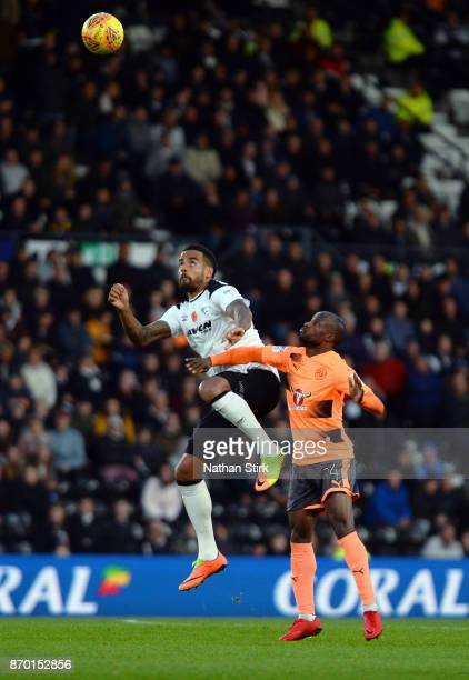 Tom Huddlestone of Derby County and Sone Aluko of Reading in action during the Sky Bet Championship match between Derby County and Reading at iPro...