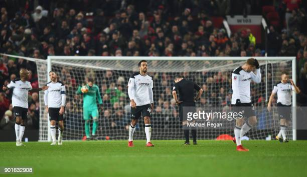 Tom Huddlestone of Derby County and team mates look dejected during the Emirates FA Cup Third Round match between Manchester United and Derby County...