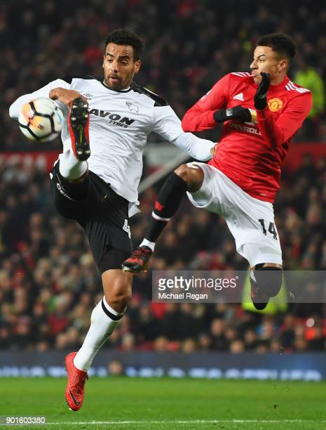 Tom Huddlestone of Derby County jumps for the ball with Jesse Lingard of Manchester United during the Emirates FA Cup Third Round match between...