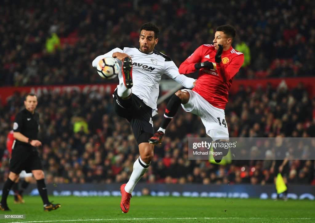 Tom Huddlestone of Derby County jumps for the ball with Jesse Lingard of Manchester United during the Emirates FA Cup Third Round match between Manchester United and Derby County at Old Trafford on January 5, 2018 in Manchester, England.