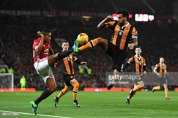Tom Huddlestone of Hull City and Antonio Valencia of Manchester United battle for possession during the EFL Cup SemiFinal First Leg match between...