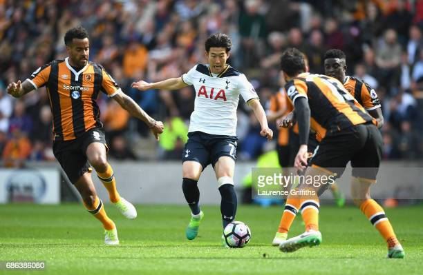 Tom Huddlestone of Hull City and HeungMin Son of Tottenham Hotspur battle for possession during the Premier League match between Hull City and...