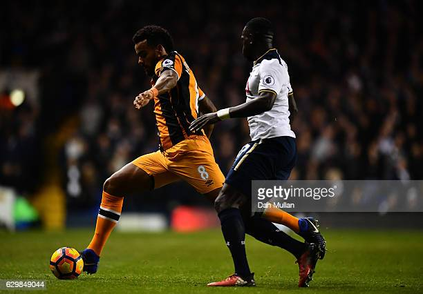 Tom Huddlestone of Hull City and Moussa Sissoko of Tottenham Hotspur compete for the ball during the Premier League match between Tottenham Hotspur...
