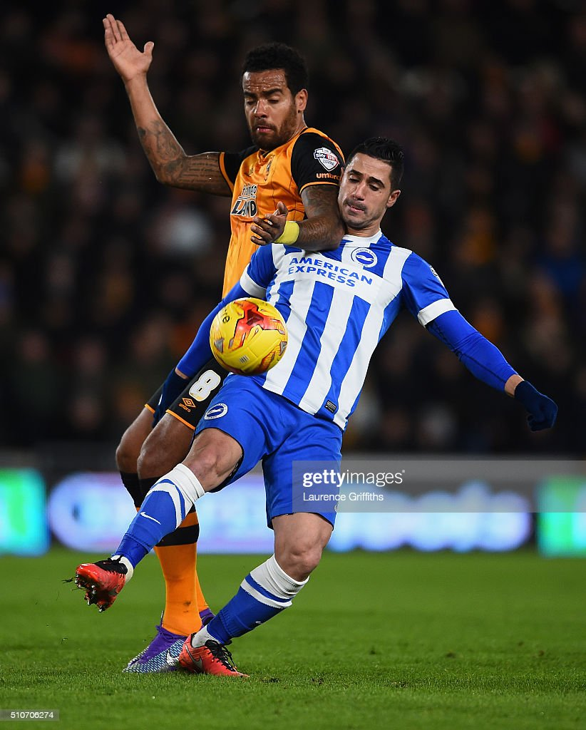 Tom Huddlestone of Hull City battles with Anthony Knockaert of Brighton and Hove Albion during the Sky Bet Championship match between Hull City and Brighton and Hove Albion at KC Stadium on February 16, 2016 in Hull, United Kingdom.