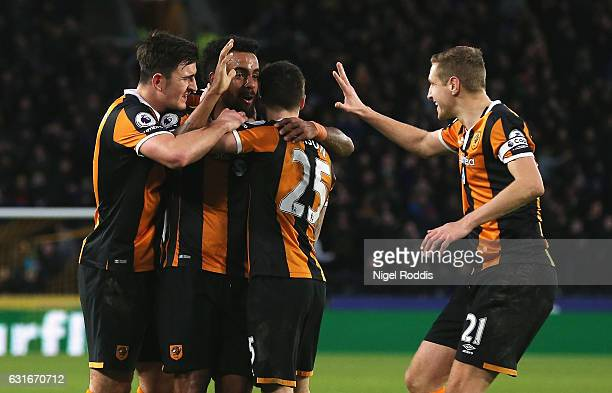 Tom Huddlestone of Hull City celebrates his side third goal with his Hull City team mates during the Premier League match between Hull City and AFC...
