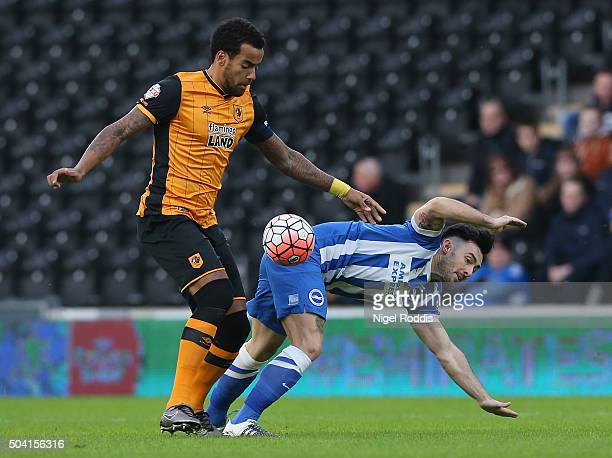 Tom Huddlestone of Hull City challenges of Richie Towell of Brighton Hove Albion during The Emirates FA Cup Third Round match between Hull City and...