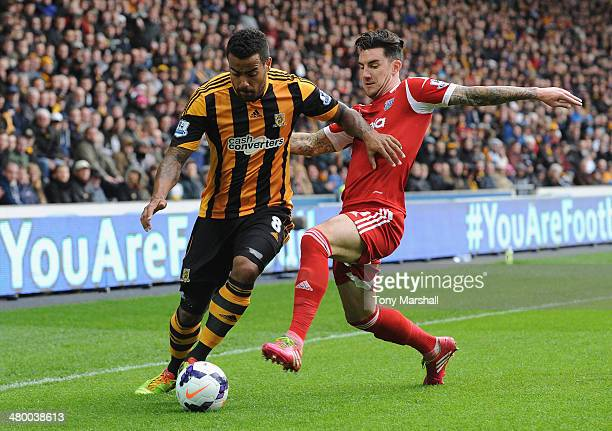 Tom Huddlestone of Hull City competes with Liam Ridgewell of West Bromwich Albion during the Barclays Premier League match between Hull City and West...