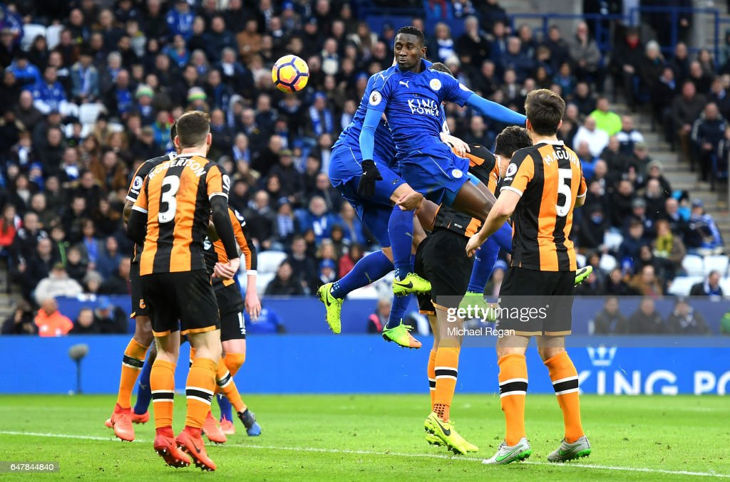 Tom Huddlestone of Hull City (L/obscure) deflects Wilfred Ndidi of Leicester City (R) header into his own net for Leicester City third goal of the game during the Premier League match between Leicester City and Hull City at The King Power Stadium on March 4, 2017 in Leicester, England.